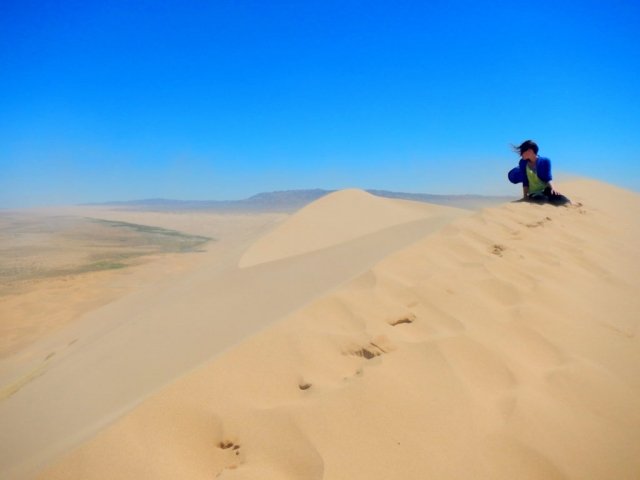 At the top of the dunes in Khongoriin Els, Gobi Desert, Mongolia