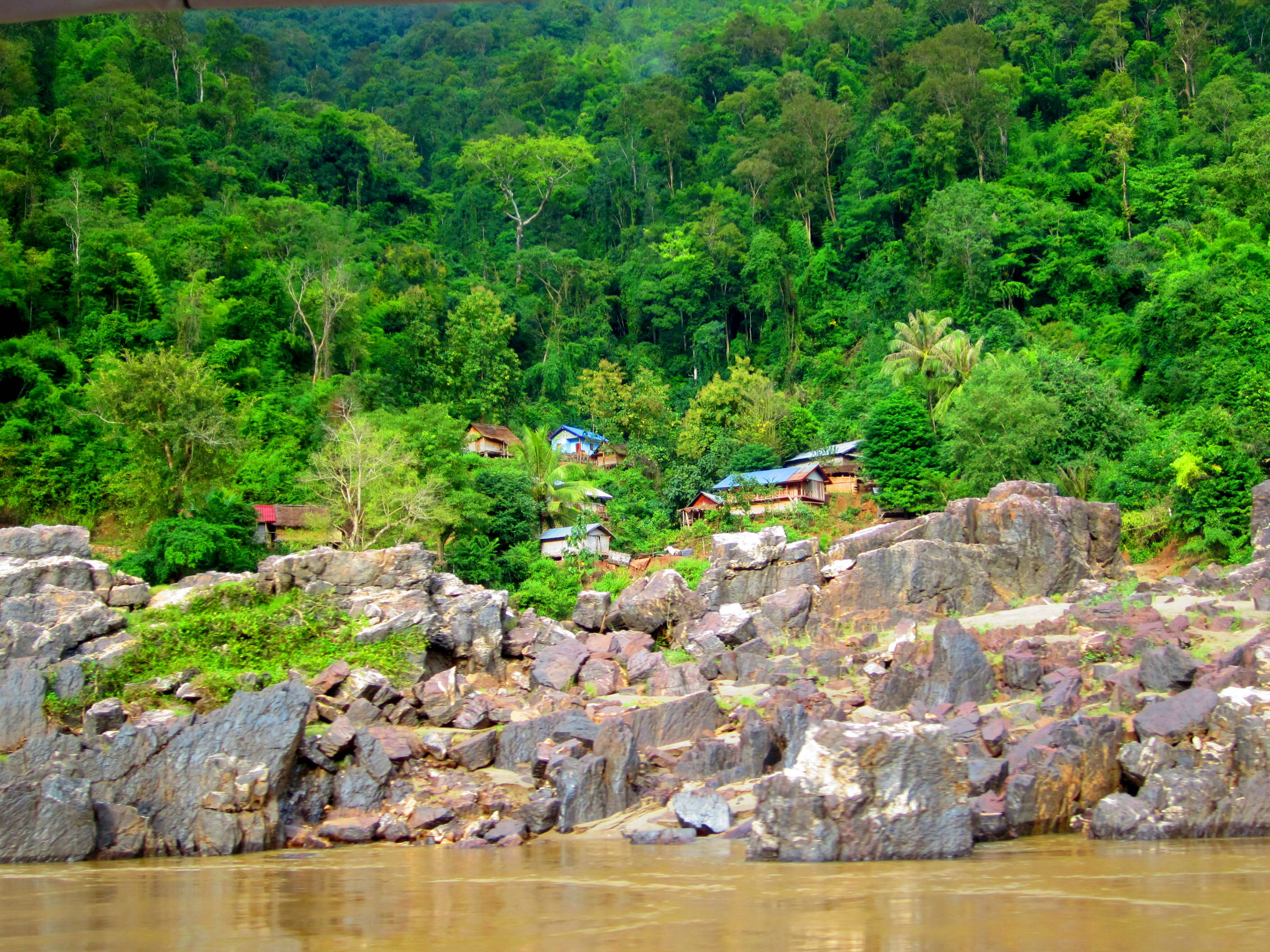Town on the riverbank. Taking the riverboat from Laos back to Thailand