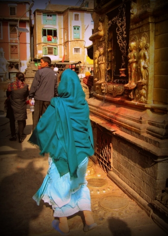 In the streets of Kathmandu, Nepal, a local in her beautiful sari