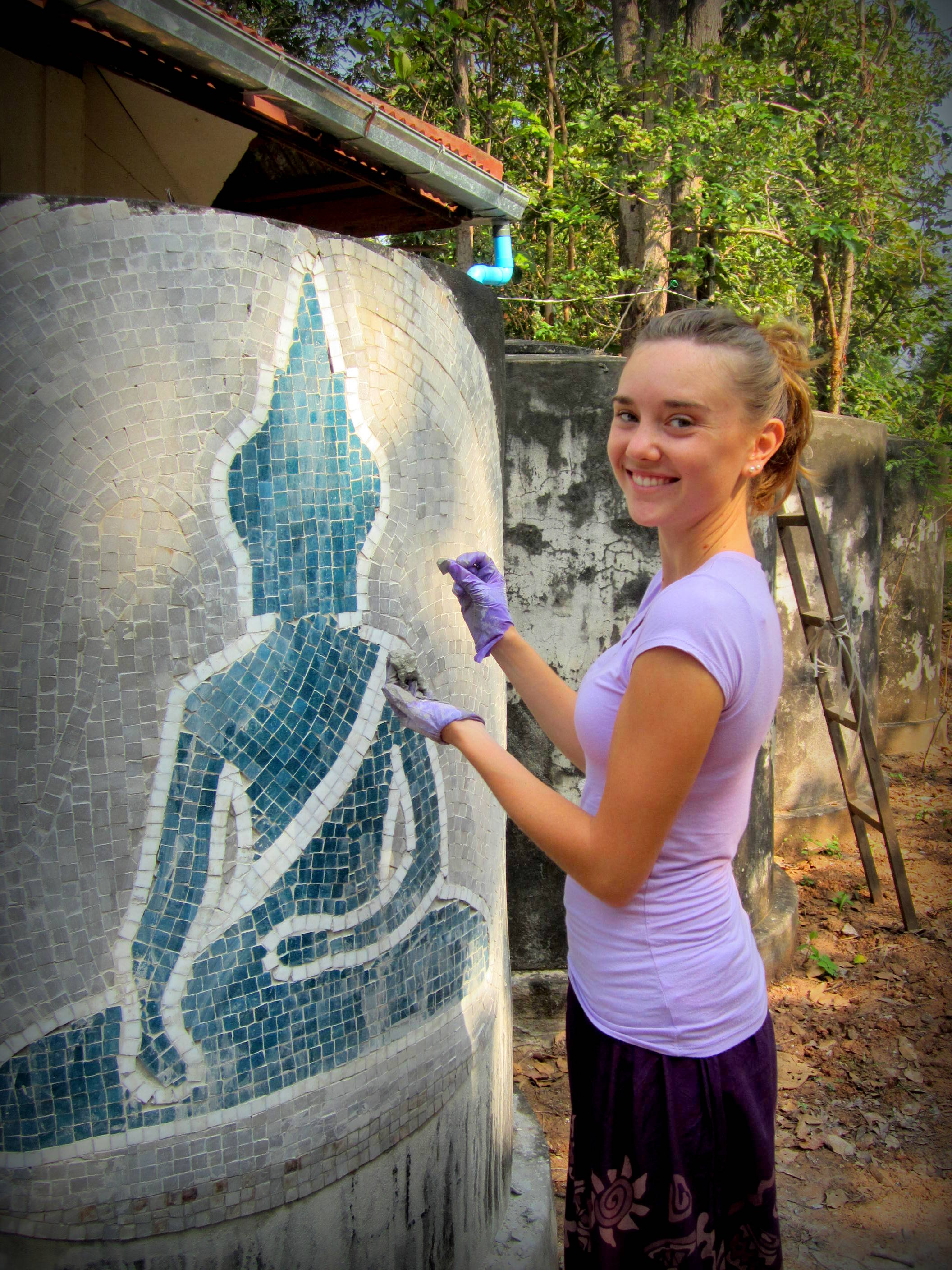 Working on a mosaic for the Mindfulness Project's jungle monastery, near Khon Kaen Thailand.