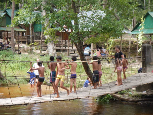Local children swimming in the Kulen stream