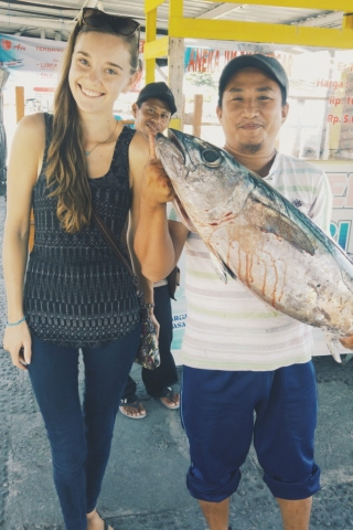 Indonesia, Ampana- he thought I'd like to have a photo with his big bloody fish. Ah, how well he knows me.