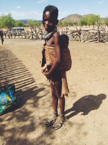 Opuwa, Namibia - Himba tribe. Her name was Ana, and she was watching after her little sister.